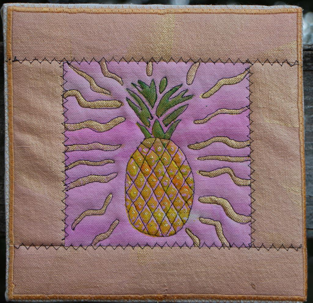 Pineapple  with gold accents on pink with peach border