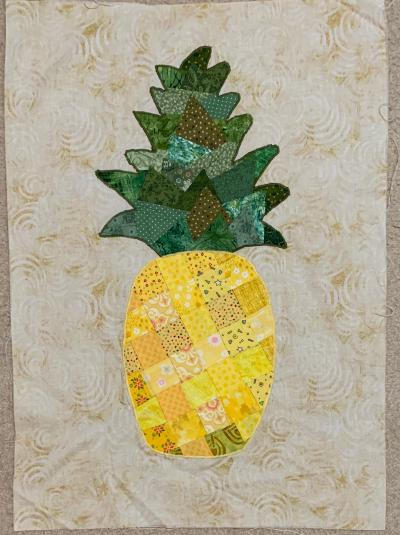 Pineapple collage with fabric woven body, appliqued to background, work in progress